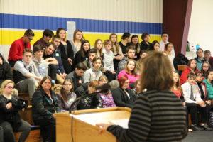 president larson addressing visiting high school students