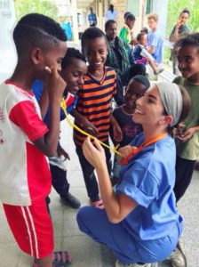 kate blanchard working with ethiopian children on mission