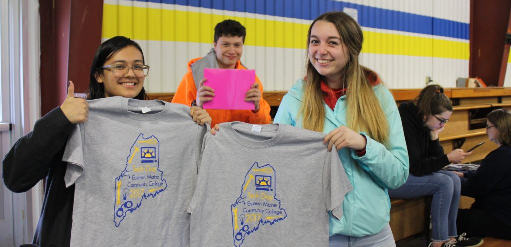 new students holding tshirts